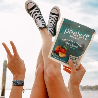 feet in the air with a bag of farmer's blend